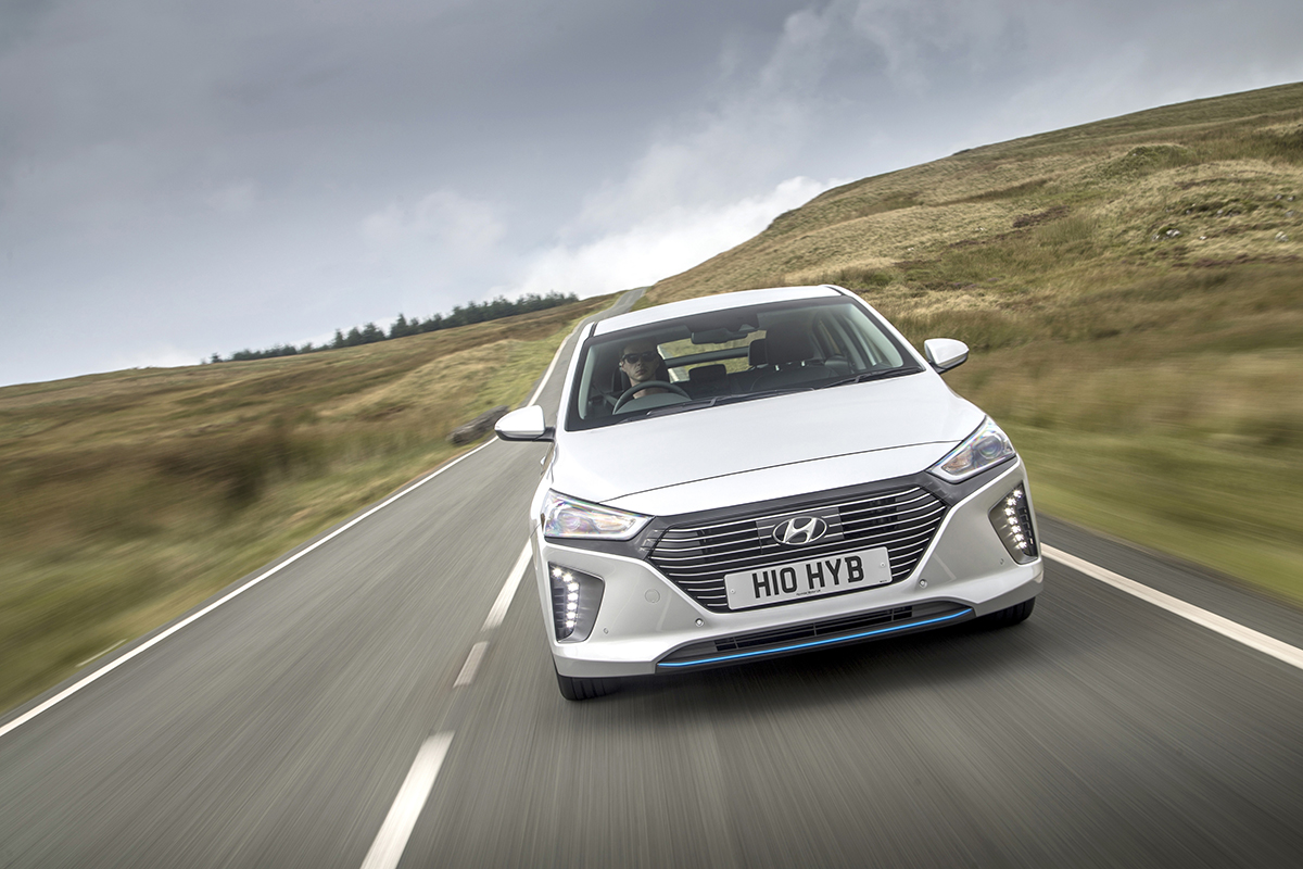 Hyundai Ioniq driving down a road - Competitor Insight